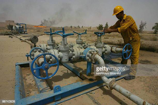 An Iraqi worker checks the valves at the Kirkuk oil field on June 29 225 kms from the capital Baghdad Iraq will unveil on June 30th which foreign...