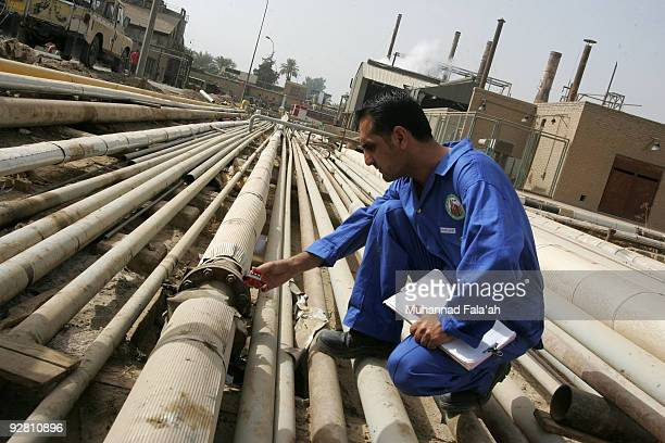 An Iraqi worker gauges gas emissions from an oil pipe at the Daura oil refinery on November 5 2009 in Baghdad Iraq Iraq and a grouping of US and...