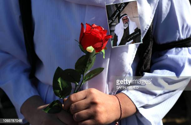 An Iraqi Yazidi carries a rose during the funeral of the Mir TakhsinBeg the hereditary leader of the Yazidi community in the world in the town of...