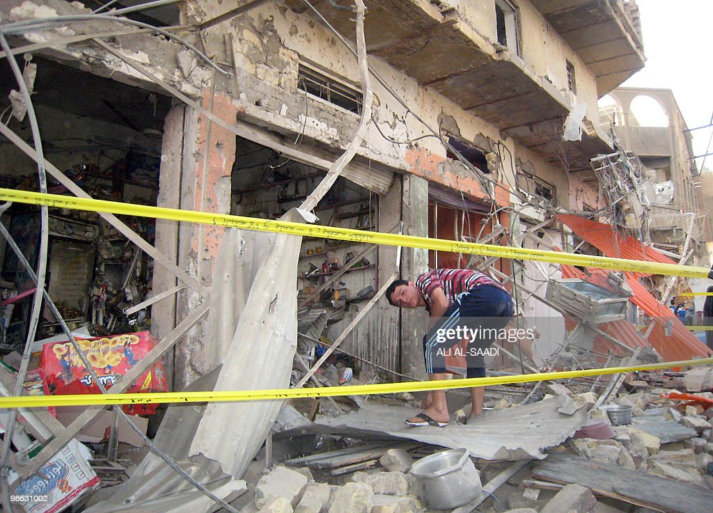 An Iraqi youth clears the rubble outside his shop after a car bomb explosion at the market of the Rahmaniya district in central Baghdad on April 23, 2010. At least 50 people were killed in a series of car bombs near Shiite mosques in Baghdad, an interior ministry official told AFP.