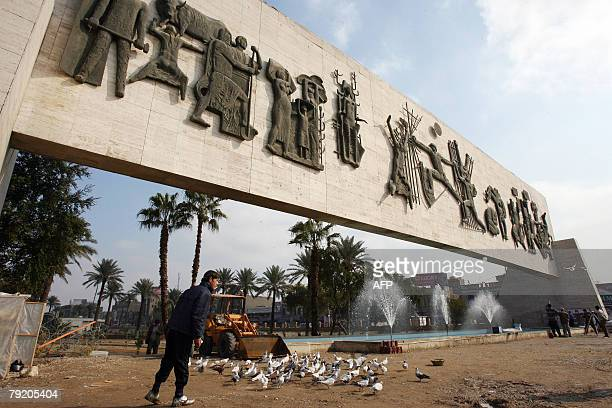 An Iraqi youth walks under the Monument of Liberty in central Baghdad 24 January 2008 Cracks in the base of the monument raised fears of collapse...