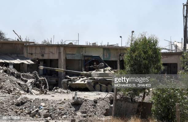An Iraqimodified T72 tank advances towards the Old City of Mosul on June 19 2017 as the ongoing offensive continues to retake the last district still...