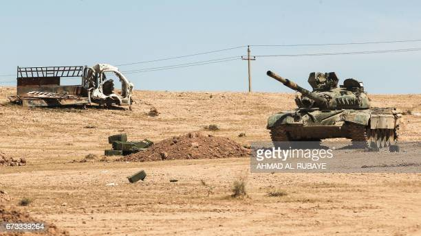 An Iraqimodified T72M tank belonging to the progovernment Hashed alShaabi paramilitary forces advances towards the UNESCOlisted ancient city of Hatra...