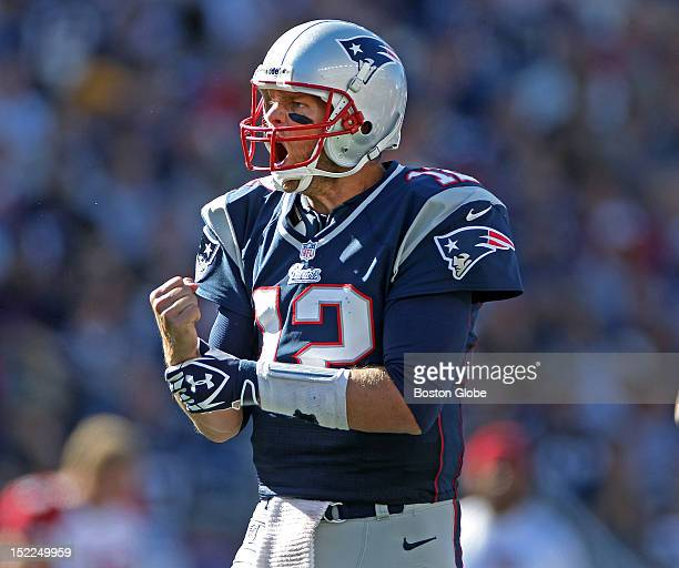 An irate New England quarterback Tom Brady screams at an official as he signals that he thought his tight end Rob Gronkowski not pictured had been...