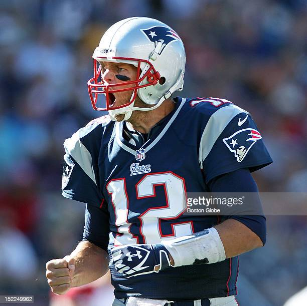 An irate New England quarterback Tom Brady screams at an official when he thought his tight end Rob Gronkowski not pictured had been held on a fourth...