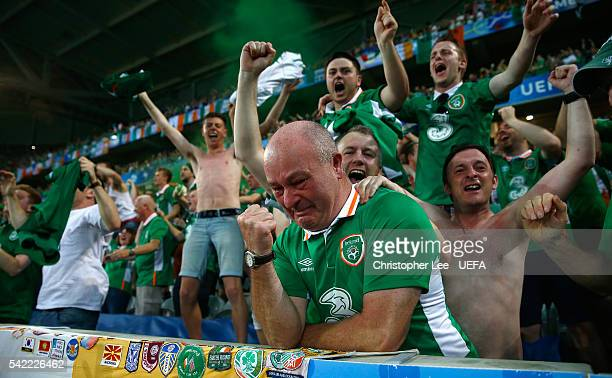 An Ireland fan looks in tears as he and fellow fans celebrate Ireland's winning goal during the UEFA EURO 2016 Group E match between Italy and...