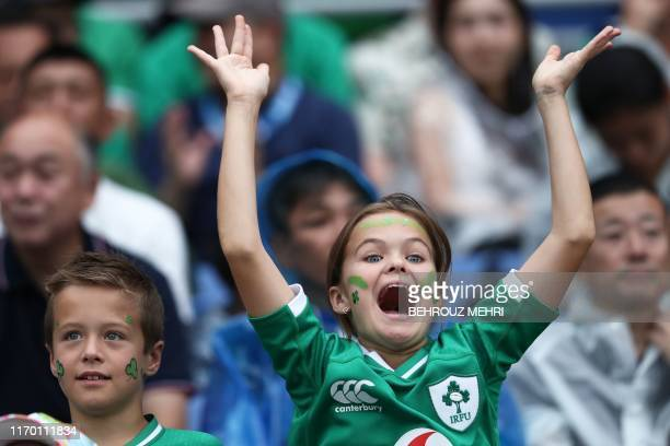 TOPSHOT An Ireland supporter cheers prior to the Japan 2019 Rugby World Cup Pool A match between Ireland and Scotland at the International Stadium...