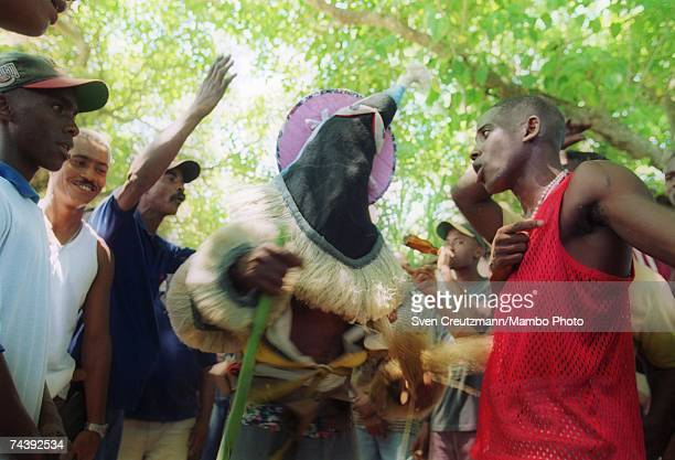 An 'Ireme' or 'Diablito' dances with a 'Nianigo' at a ceremony during a twoday initiation rite for new members on July 20 2000 in the town of...