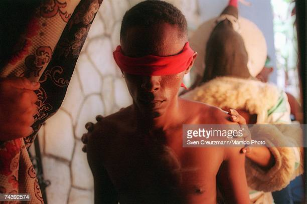 An 'Ireme' or 'Diablito' leads a blindfolded 'Indeceme' to a larger room where the main part of an Abacua a twoday initiation ceremony will take...