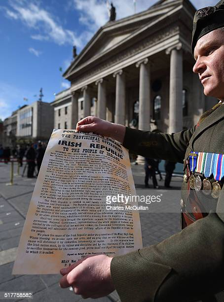 An Irish army commandant displays the Irish republic's proclamation during the 1916 Easter Rising commemoration parade marking the 100th anniversary...