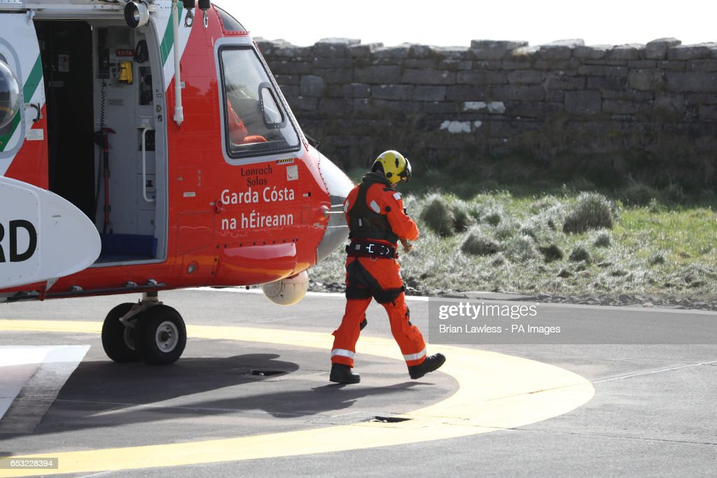 An Irish Coastguard helicopter returns to Blacksod, Co Mayo for refuelling, as the search continues for an Irish Coast Guard helicopter which went missing off the west coast of Ireland in the early hours of the morning.