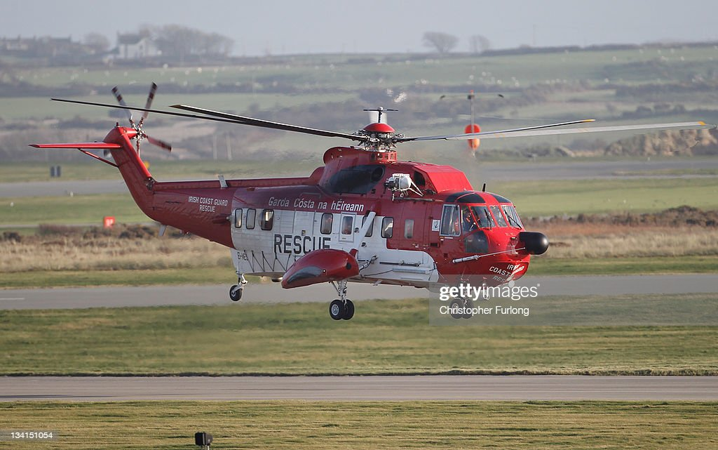 An Irish Coastguard Rescue helicopter leaves RAF Valley as the search continues for the crew of cargo vessel The Swanland which sank off north Wales on November 27, 2011 in Anglesey, Wales. Five crew are still missing after the recovery of one body today. Prince William, Duke of Cambridge, is a search and rescue helicopter co-pilot and took part in the rescue last night which saved two crewmen.