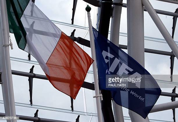 An Irish flag flies next to a FIFA flag in the stadium during the international friendly football match between Republic of Ireland and England at...