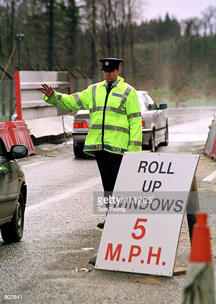 An Irish Garda stops traffic at a foot and mouth disease checkpoint April 17 2001 in County Louth on the border between Northern Ireland and the...