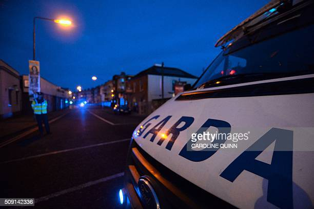 An Irish police van is parked close to the scene of a fatal shooting at a residential address in Dublin on February 9 2016 A man was shot dead in...