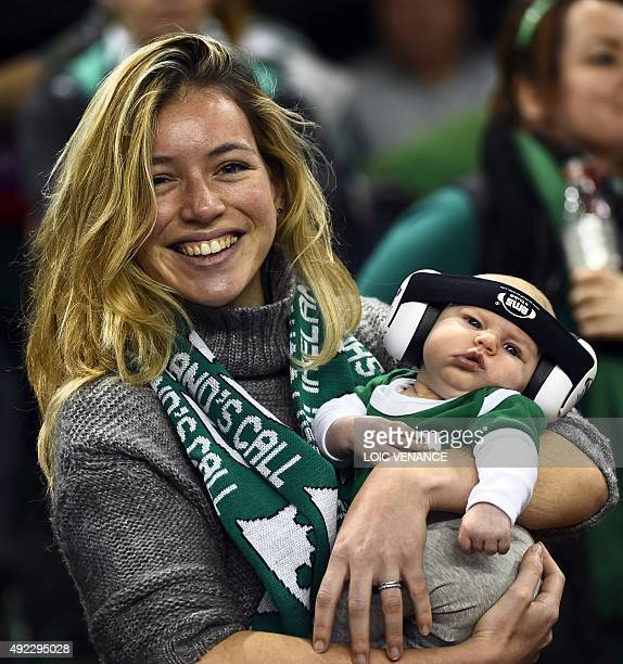 An Irish supporter poses with her newborn baby during the Pool D match of the 2015 Rugby World Cup between France and Ireland at the Millennium...