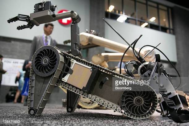 An iRobot Corp. 310 small unmanned ground vehicle is displayed on the exhibition floor at the Association for Unmanned Vehicle Systems International...