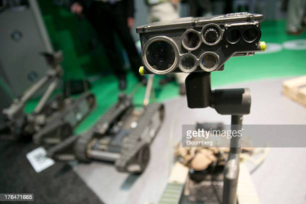 An iRobot Corp. XM1216 small unmanned ground vehicle is displayed on the exhibition floor at the Association for Unmanned Vehicle Systems...