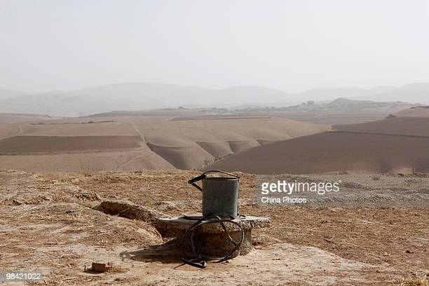 An iron bucket is seen on a cistern in a farmer's yard on March 12 2010 in Xihaigu Tongxin County of Ningxia Hui Autonomous Region north China...