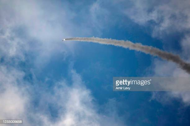 An Iron Dome anti-missile rocket launches to intercept a rocket fired from the Gaza Strip on May 20, 2021 in Ashdod, Israel. The Hamas-run health...