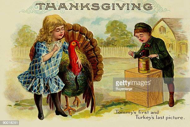 An ironic vintage postcard to be sent for Thanksgiving A little girl poses with the majestic turkey as a little boy snaps a picture of the two The...