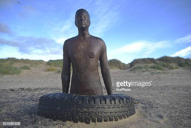 An ironwork statue standing with other statues in the public art exhibition called 'Another Place' on Crosby beach Crosby Sefton England on Tuesday...