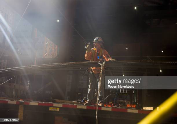 An ironworker secures rebar to a crane line as construction work continues at the One Vanderbilt skyscraper office building adjacent to Grand Central...