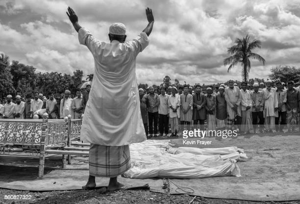 COX'S BAZAR BANGLADESH SEPTEMBER 29 An Islamic cleric leads prayers for 16 Rohingya refugees who dies when their boat capsized while fleeing Myanmar...