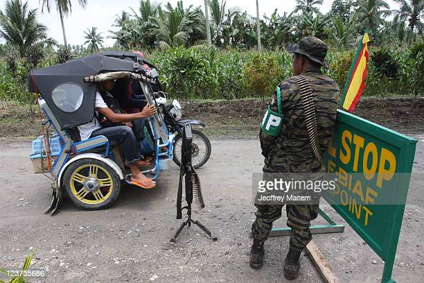 An Islamic rebel of the Moro Islamic Liberation Front is seen at the check point inside their camp on September 5, 2011 in the southern Philippine...