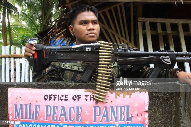 An Islamic rebel of the Moro Islamic Liberation Front is seen inside their camp on September 5, 2011 in the southern Philippine township of Sultan...