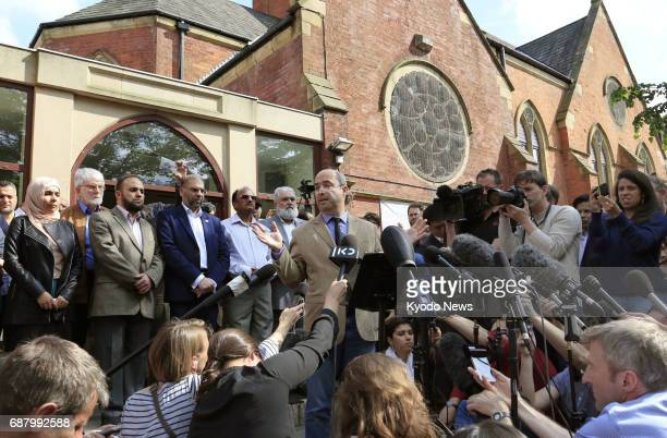 An Islamic representative meets with reporters in front of a mosque in Manchester England that suspected suicide bomber Salman Abedi is said to have...