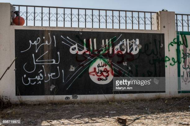 An Islamic State sign in the north-western Iraq town of Ba'aj, June 20 near the Iraq-Syria border. The Popular Mobilisation Front forces, composed of...