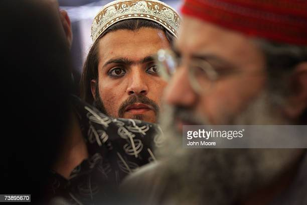 An Islamic student listens as cleric Abdul Rashid Ghazi gives a press conference April 16 2007 at the Lal Mosque in Islamabad Pakistan He said that a...