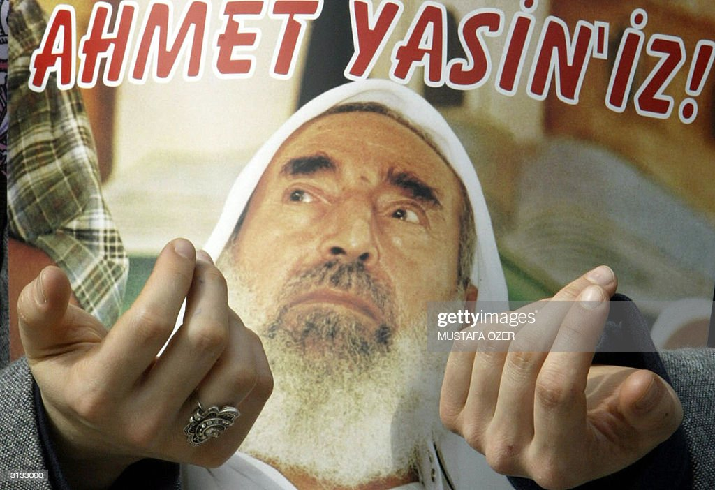 An Islamic Turkish woman holds a posters : News Photo