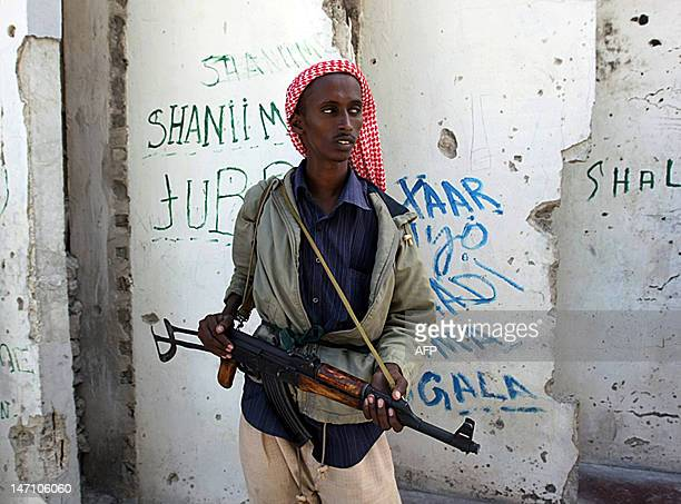 An Islamist militant loyal to newly elected President Shaikh Sharif Sheikh Ahmed takes up position at a roadblock in Mogadishu on February 19 2009...