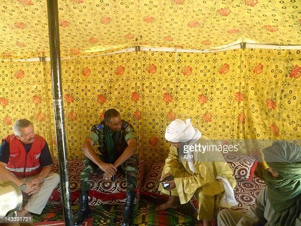 An Islamist rebel of Ansar Dine talks with General Gilbert Diendere Burkina Faso presidency chief of staff on April 24 2012 near Timbuktu rebelheld...