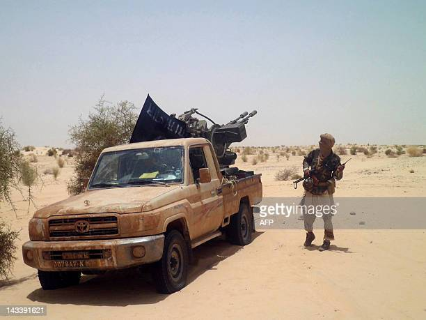 An Islamists rebel of Ansar Dine is pictured on April 24, 2012 near Timbuktu, rebel-held northern Mali, during the release of a Swiss hostage....