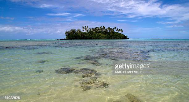 An island dots Muri beach on the Island of Rarotonga the largest island in the Cook Islands is viewed from the air on August 30 2012 AFP PHOTO /...