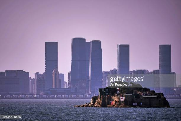 An Island that lies inside Taiwan's territory is seen with the Chinese city of Xiamen in the background on February 04, 2021 off the coast of Lieyu,...