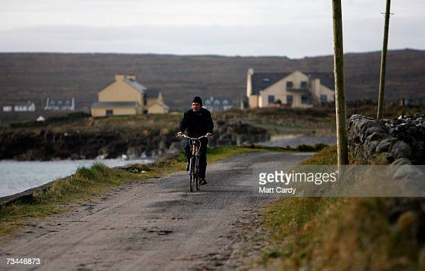 An islander cycles on February 26 2007 in Inis Mor Ireland The largest of the remote three Aran Islands with a population of just 1200 had a recent...