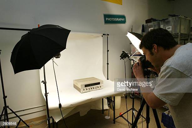 An iSold It eBay services store employee photographs customers' items February 3 2004 in Pasadena California iSold It has joined the ranks of new...