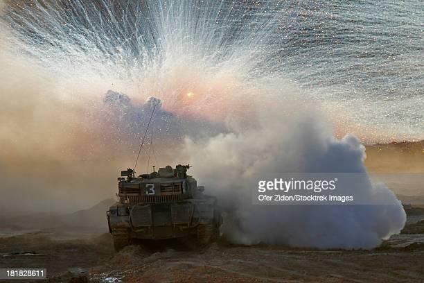 An Israel Defense Force Merkava Mark II main battle tank during live fire exercise in the Negev desert.