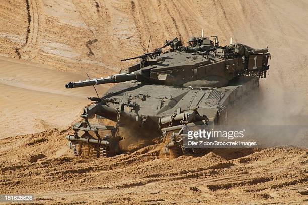 An Israel Defense Force Merkava Mark II main battle tank with mine clearing device attached to its front.