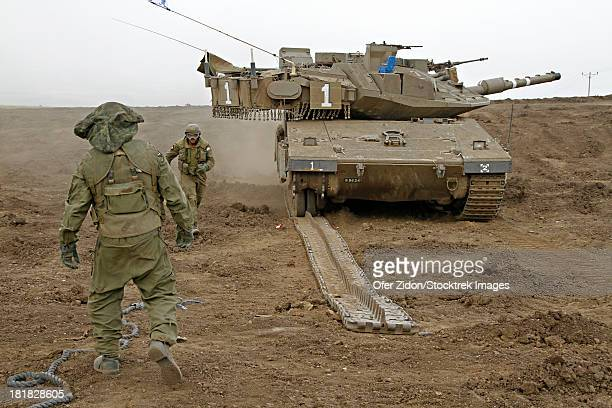 An Israel Defense Force Merkava Mark IV main battle tank during track replacement drill.