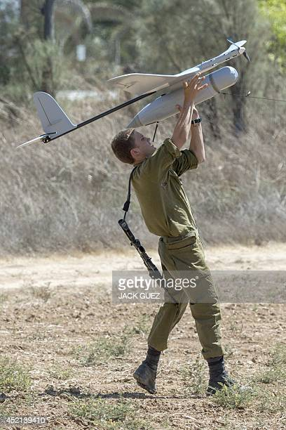 An Israel soldier prepares to launch an Israeli army's Skylark I unmanned drone aircraft which is used for monitoring purposes on July 14 2014 at an...