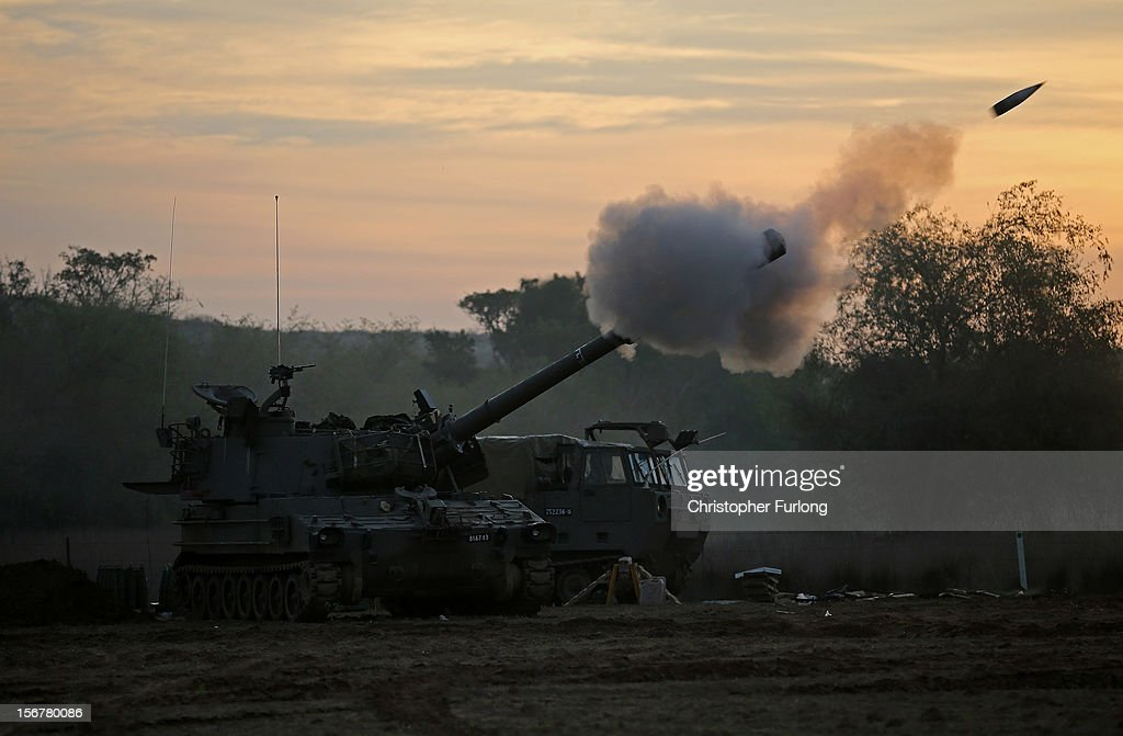 An Israeli 155mm artillery gun fires a shell from an emplacement on Israel's border into the Gaza Strip on November 21, 2012 on Israel's border with the Gaza Strip. Despite widespread rumors of a ceasefire, militants in the Gaza Strip continue to fire rockets and Israel continues its bombardment. US Secretary of State Hillary Clinton has arrived in Israel to support and encourage a peace deal being brokered by Egypt.