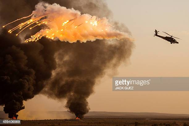 An Israeli AH64 Apache longbow helicopter launches antimissile flares during an air show at the graduation ceremony of Israeli air force pilots at...