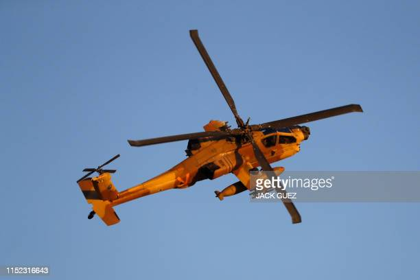 An Israeli AH64 Apache longbow helicopter performs during an air show at the graduation ceremony of Israeli Air Force pilots at the Hatzerim base in...