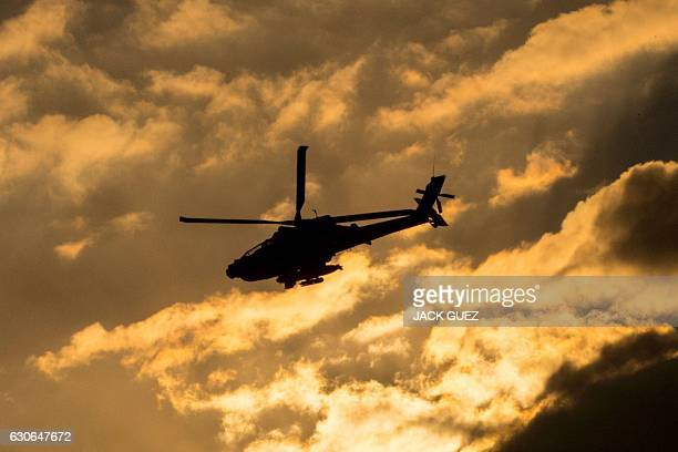 An Israeli AH64 Apache longbow helicopter performs in an air show during the graduation ceremony of Israeli air force pilots at the Hatzerim base in...