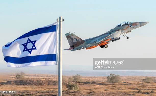 An Israeli Air Force F15 Eagle fighter plane performs at an air show during the graduation of new cadet pilots at Hatzerim base in the Negev desert...